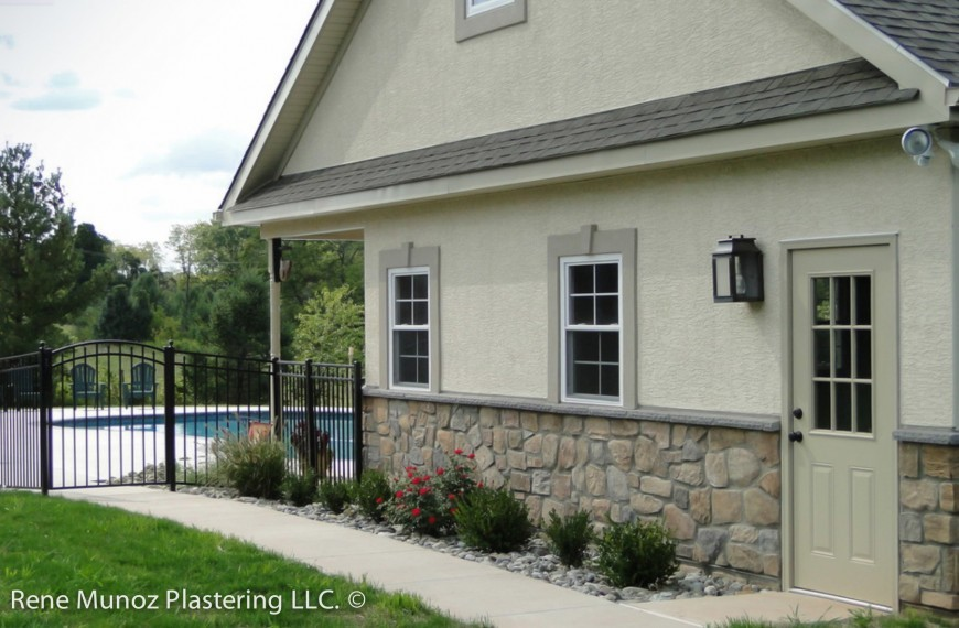 Stucco stone pool house garage quality stucco siding for Stucco garage